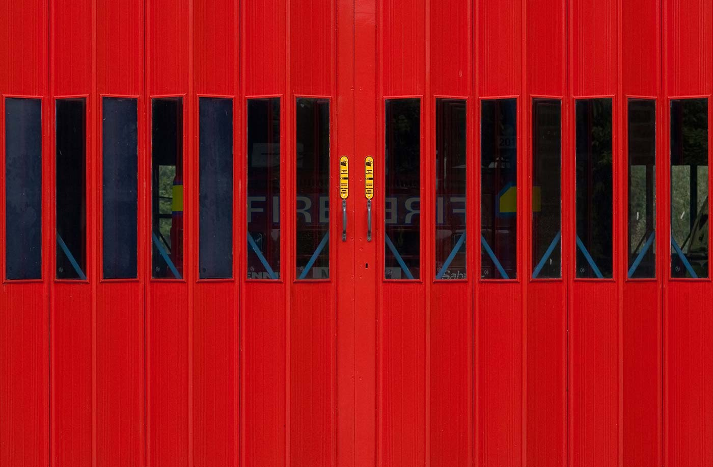 Firehall door with firetruck waiting to respond